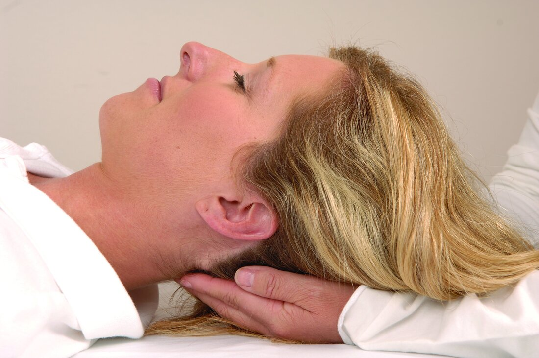 Person receiving craniosacral therapy